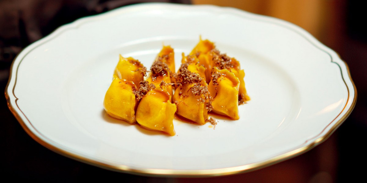 Potato Ravioli with Roast Meat Sauce and White Truffles